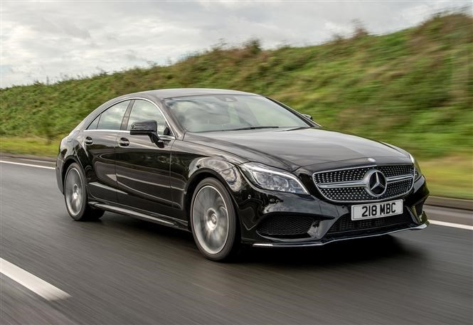 Twin Test Mercedes Benz Cls Vs Bmw 6 Series Gran Coupe Parkers