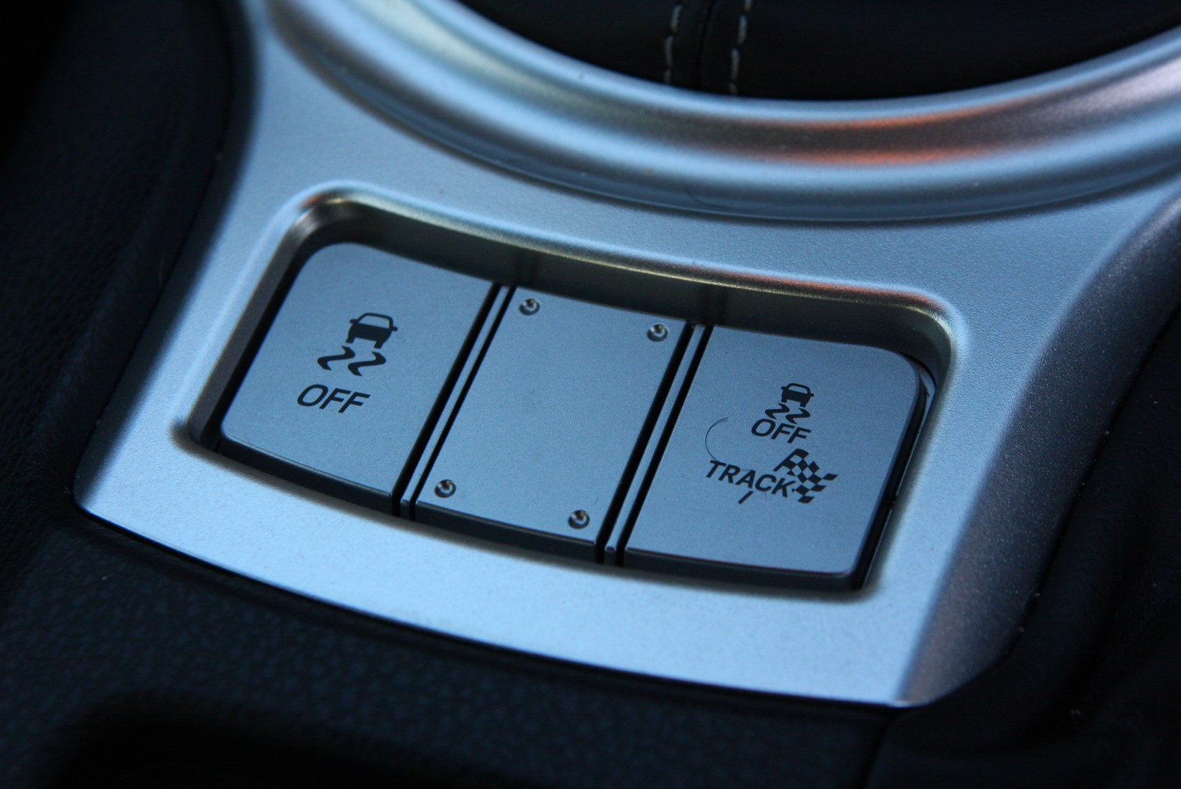 The Toyota GT86 features a pair of buttons we've not used yet - Track mode and everything switched off