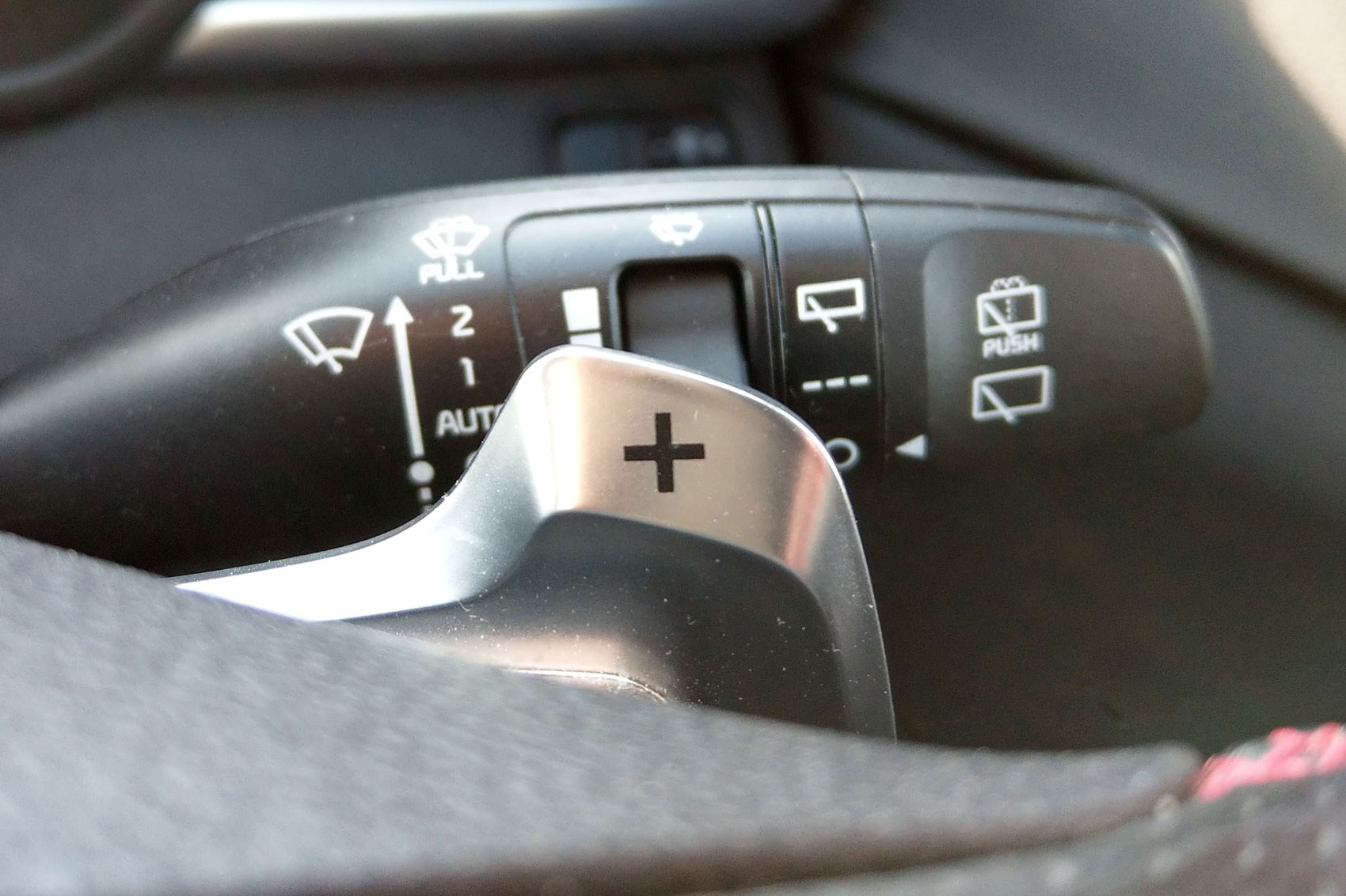 The paddleshifts behind the steering wheel on the Kia Optima Sportswagon feel incredibly cheap