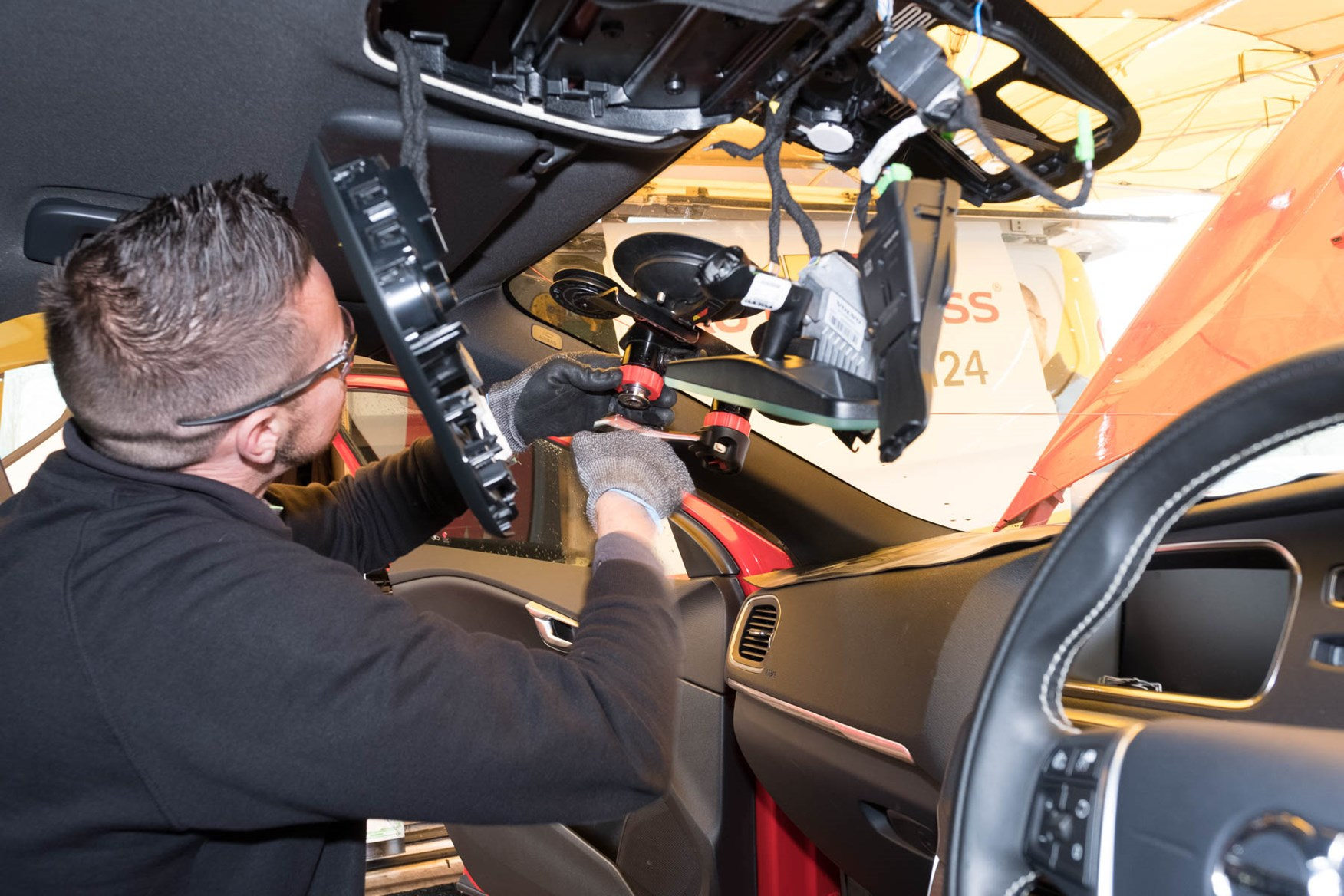 An impressive device applies torque to a thin plastic-coated string around the windscreen to cut through the seal