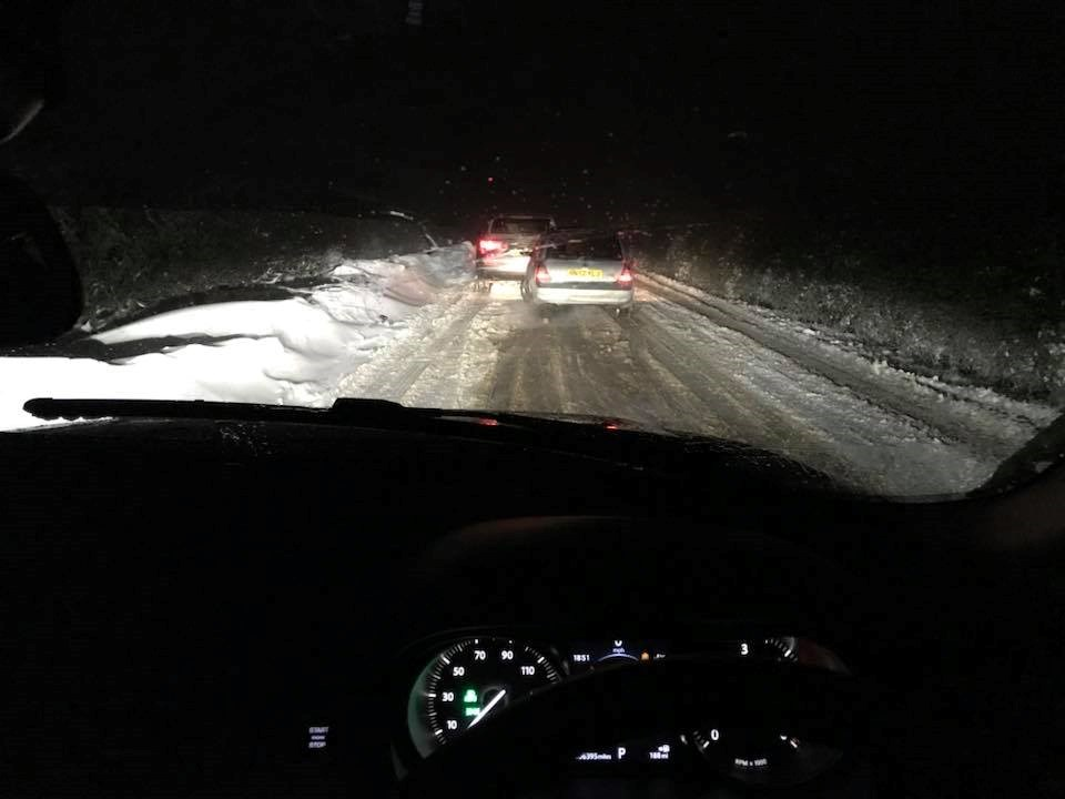 Driving in snow at night - stopped to allow a fellow motorist space!