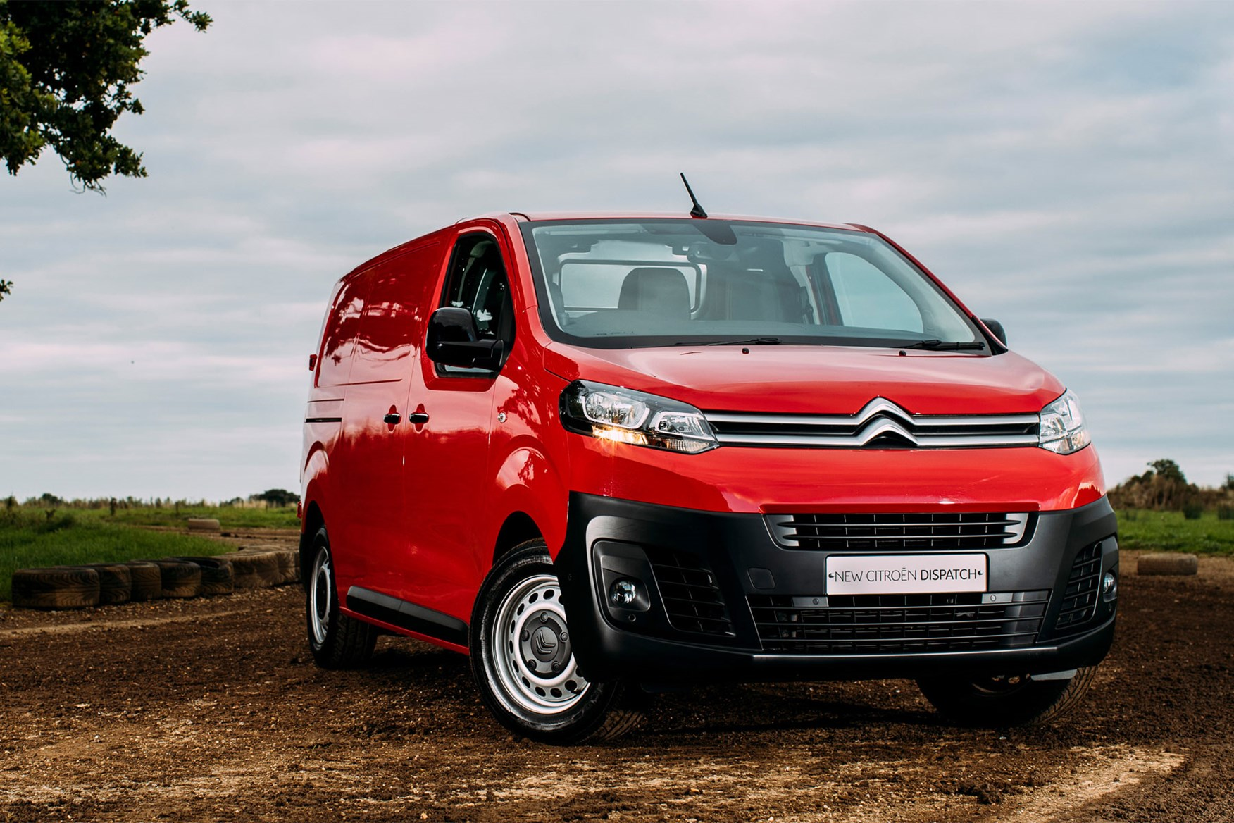 Citroen Dispatch review - front view, red, parked in muddy field