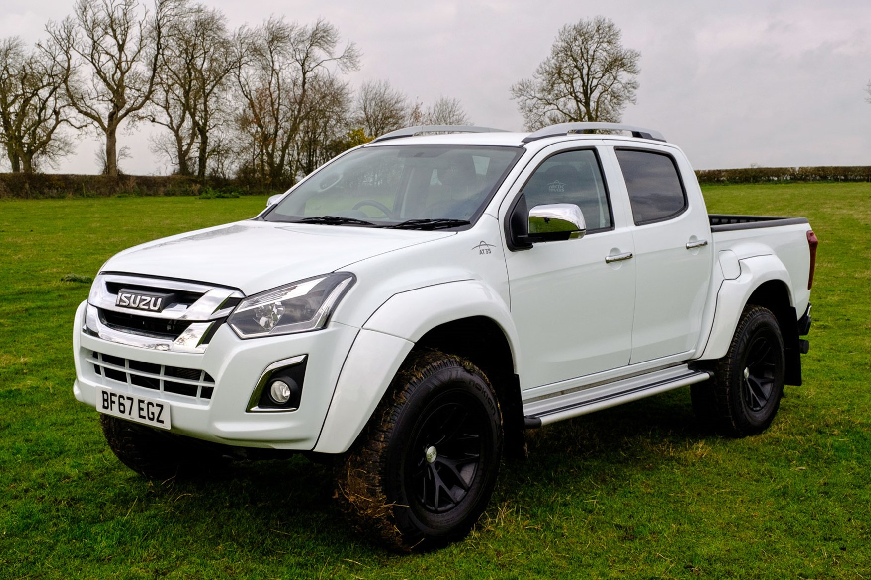 Isuzu D-Max AT35 1.9 review - front view, in field, white