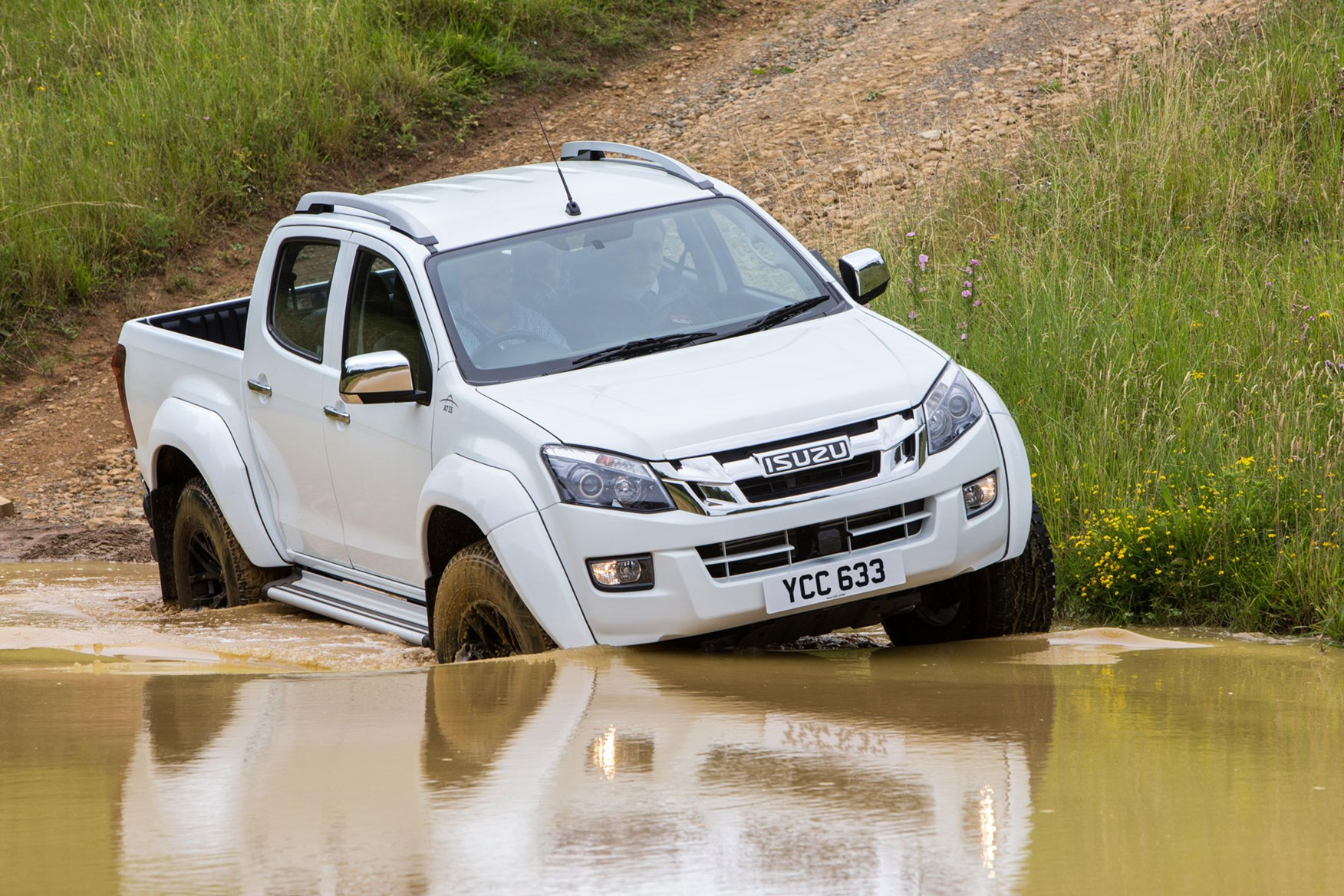 Isuzu D-Max AT35 2.5 review - front view, driving into water, white