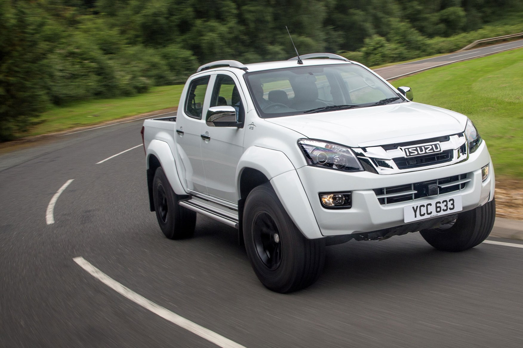 Isuzu D-Max AT35 2.5 review - front view, driving on road, white
