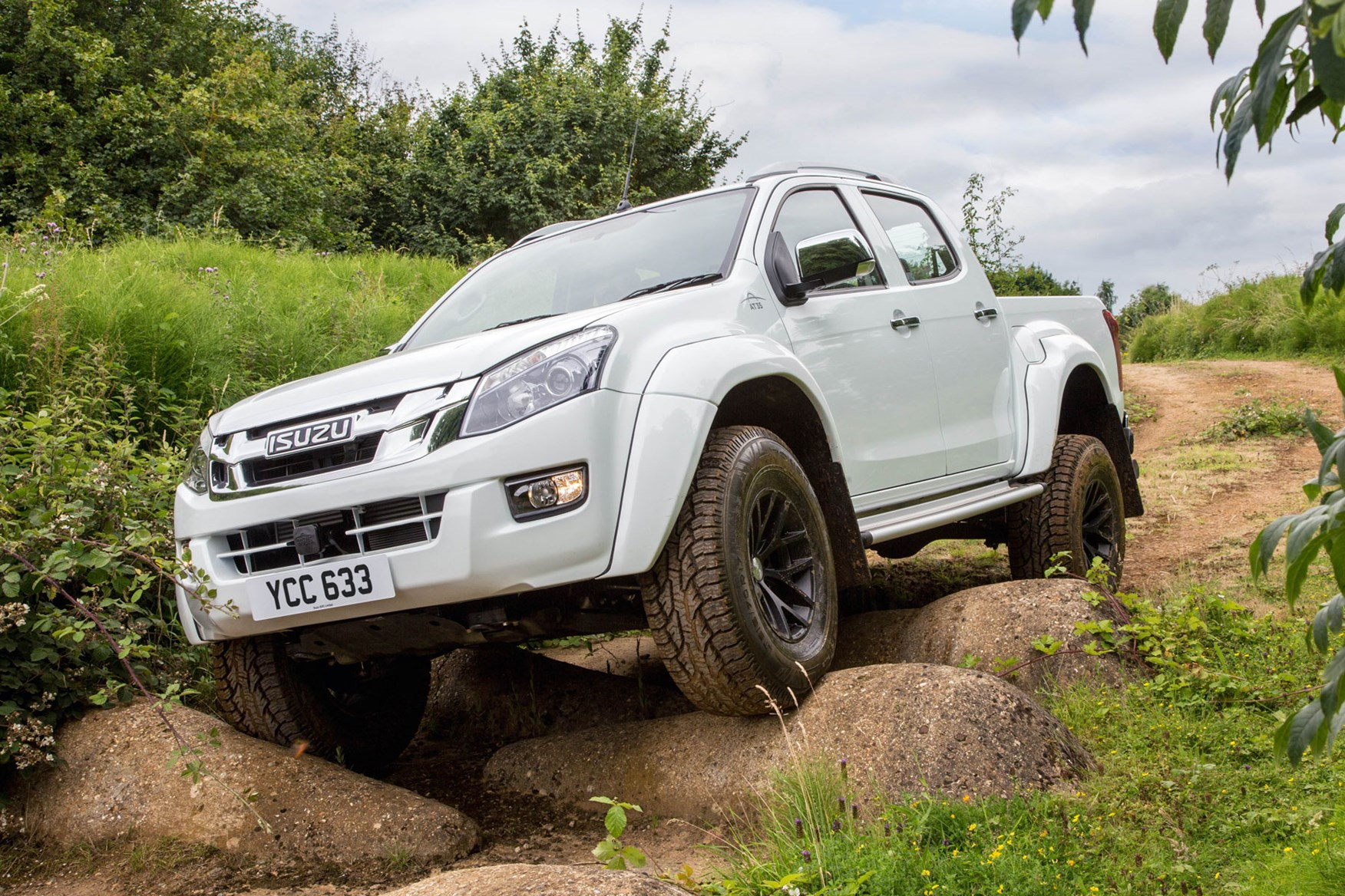 Isuzu D-Max AT35 2.5 review -  front view, climbing over large rocks, white