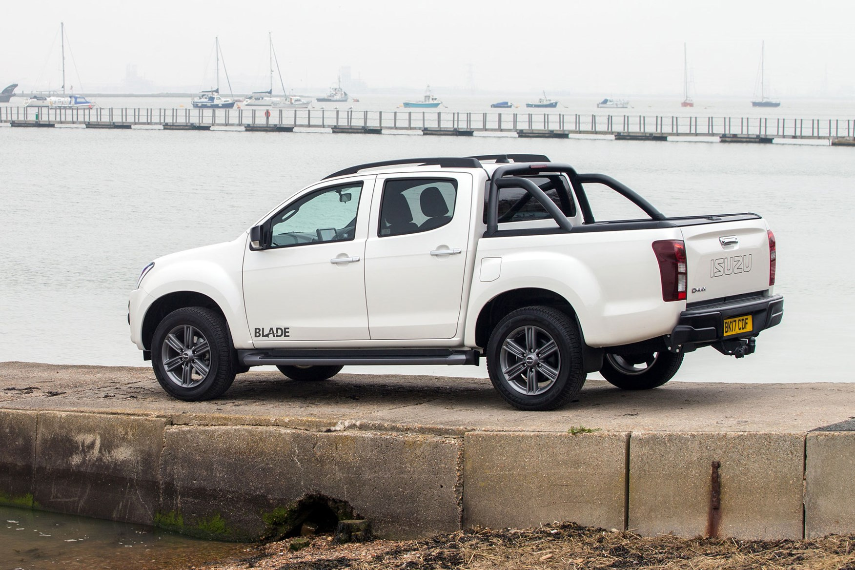 Isuzu D-Max Blade 1.9 review - side view, parked by water