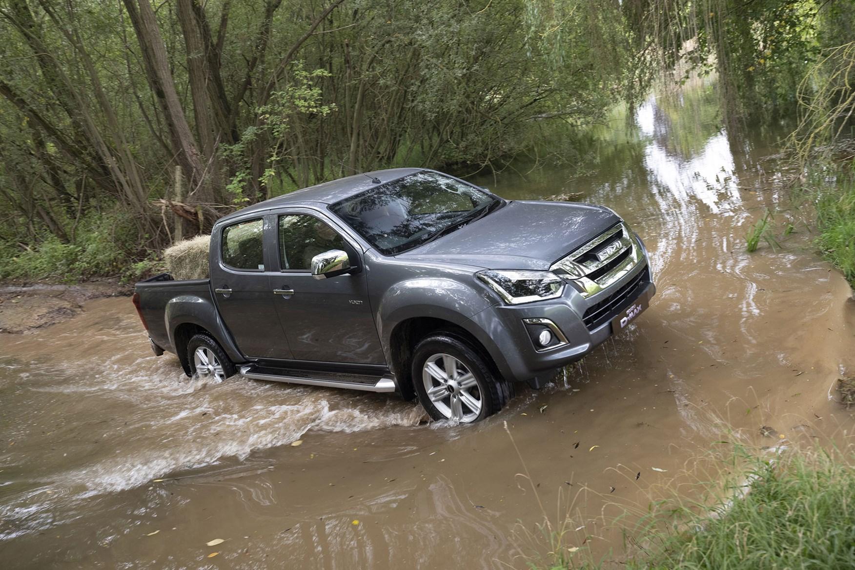 Isuzu D-Max Yukon review - wading through muddy water, grey