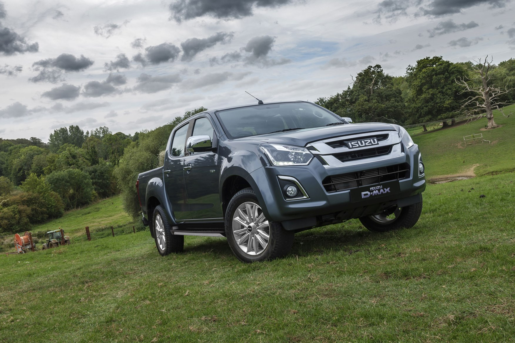 Isuzu D-Max Yukon review - grey, front view, parked in field