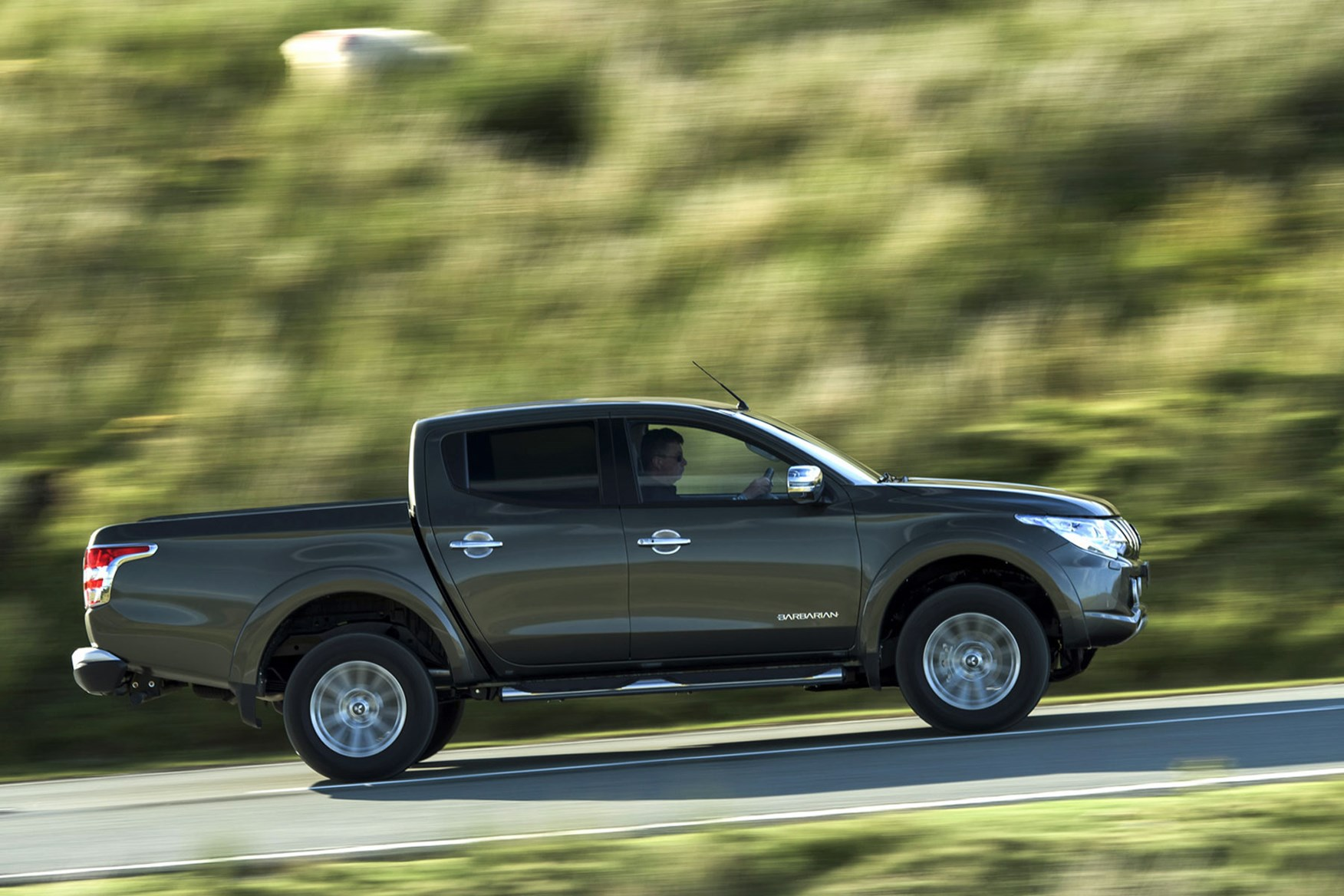 Mitsubishi L200 review, grey, side view, driving
