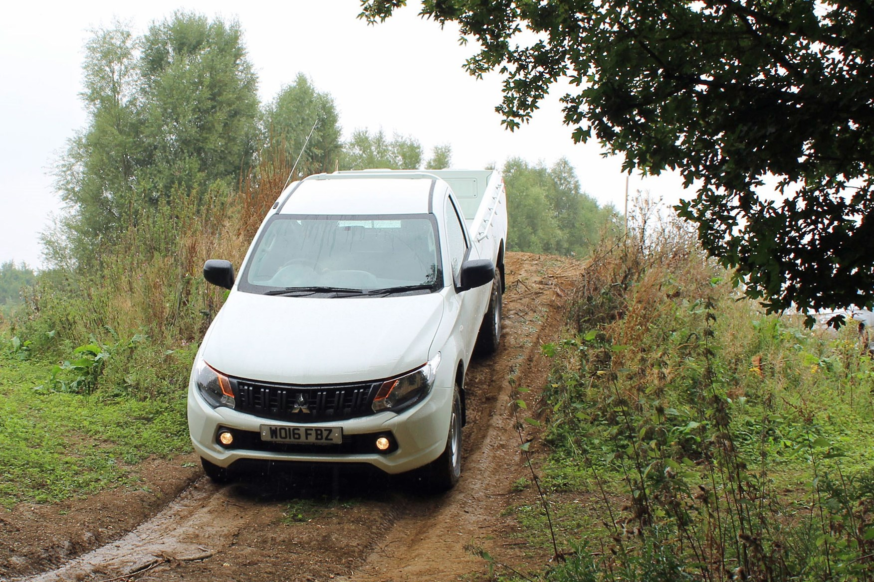 Mitsubishi L200 4Life Single Cab review - front view, driving down slope off-road, white