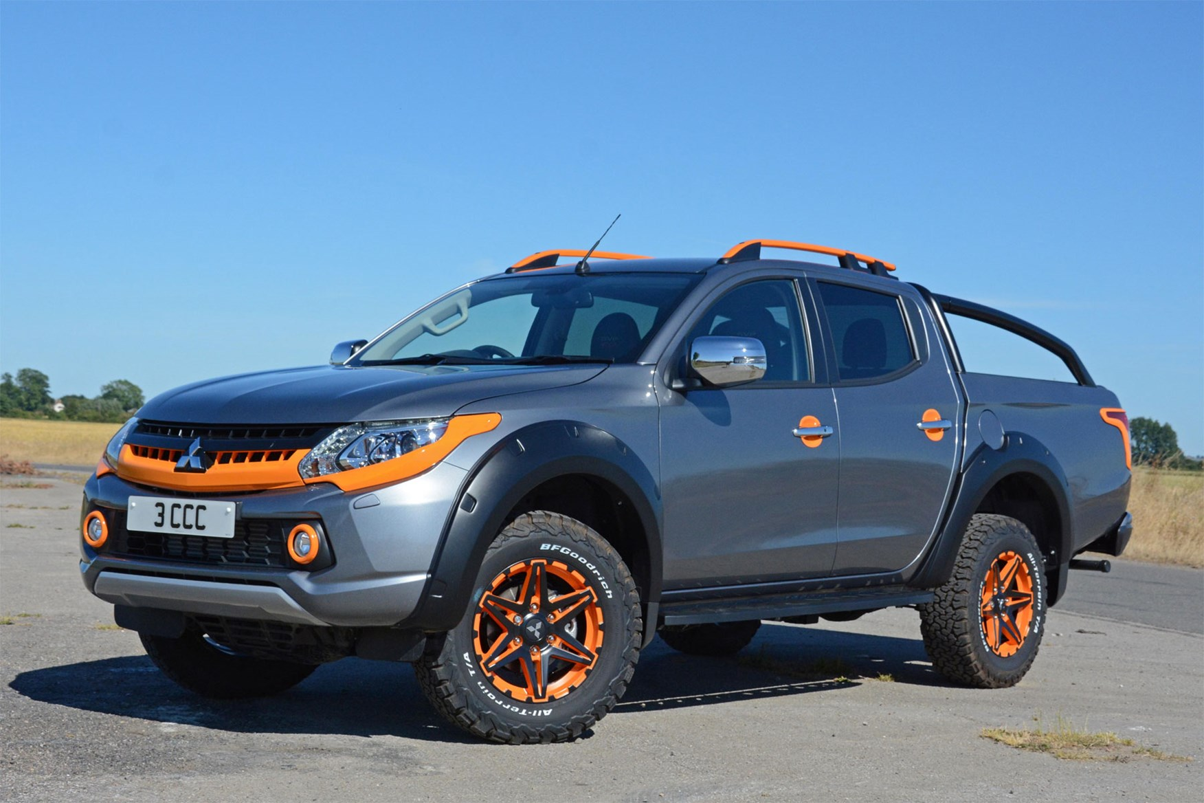Mitsubishi L200 Barbarian SVP II review - front view, grey and orange