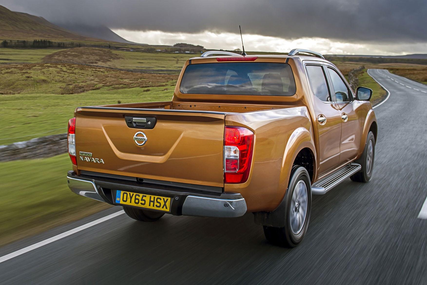 Nissan Navara review - rear view, driving, orange