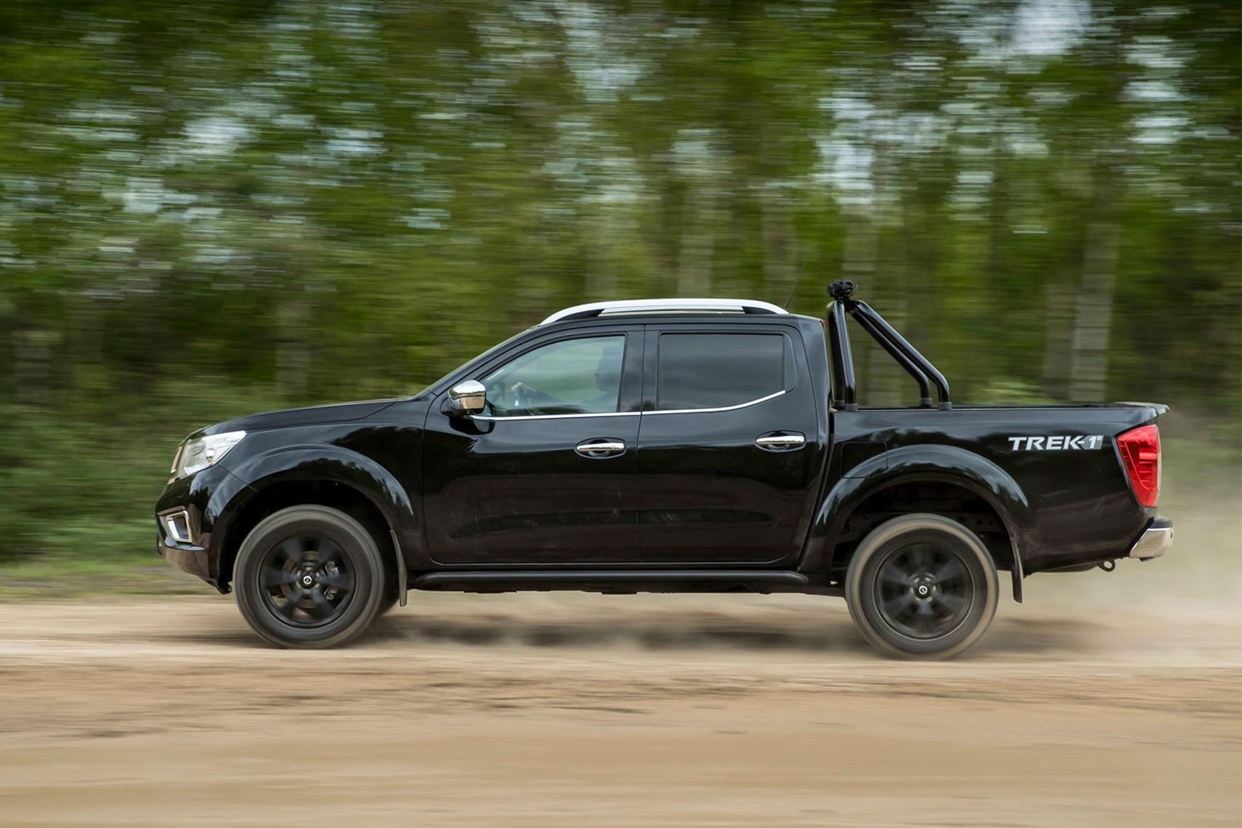 Nissan Navara Trek-1 review - side view, black, driving