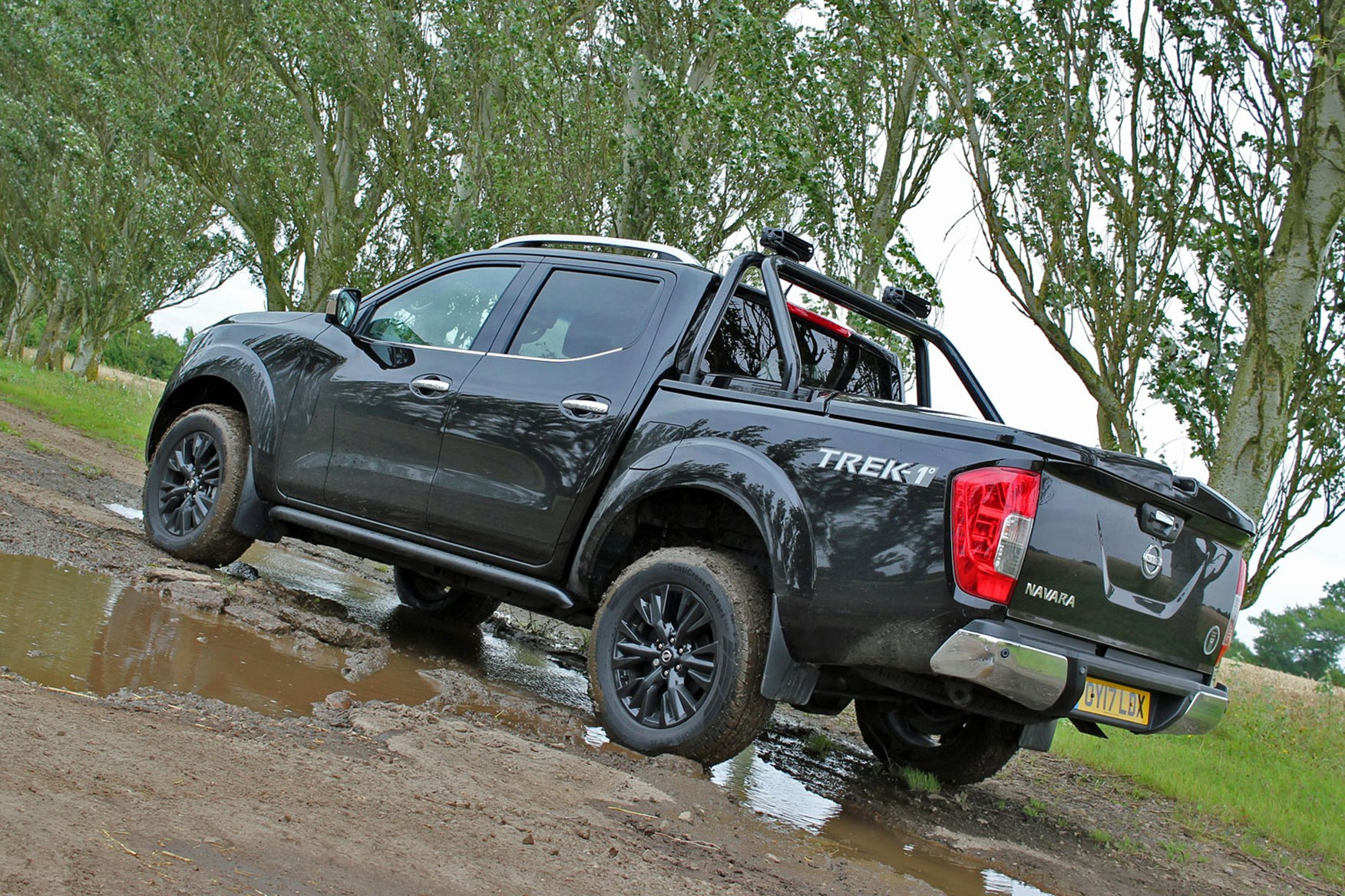 Nissan Navara Trek-1 review - rear view, black, parked in muddy puddle