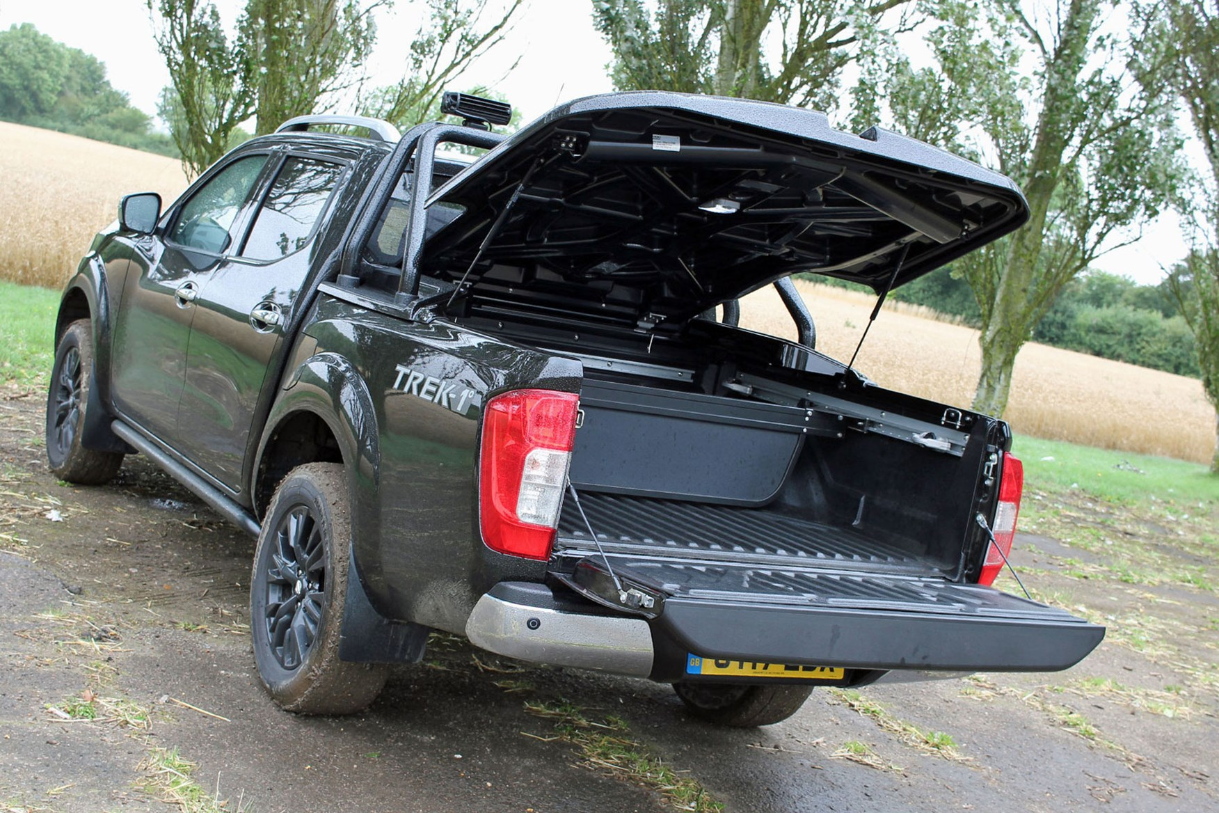 Nissan Navara Trek-1 review - rear view, black, with aero load cover canopy open
