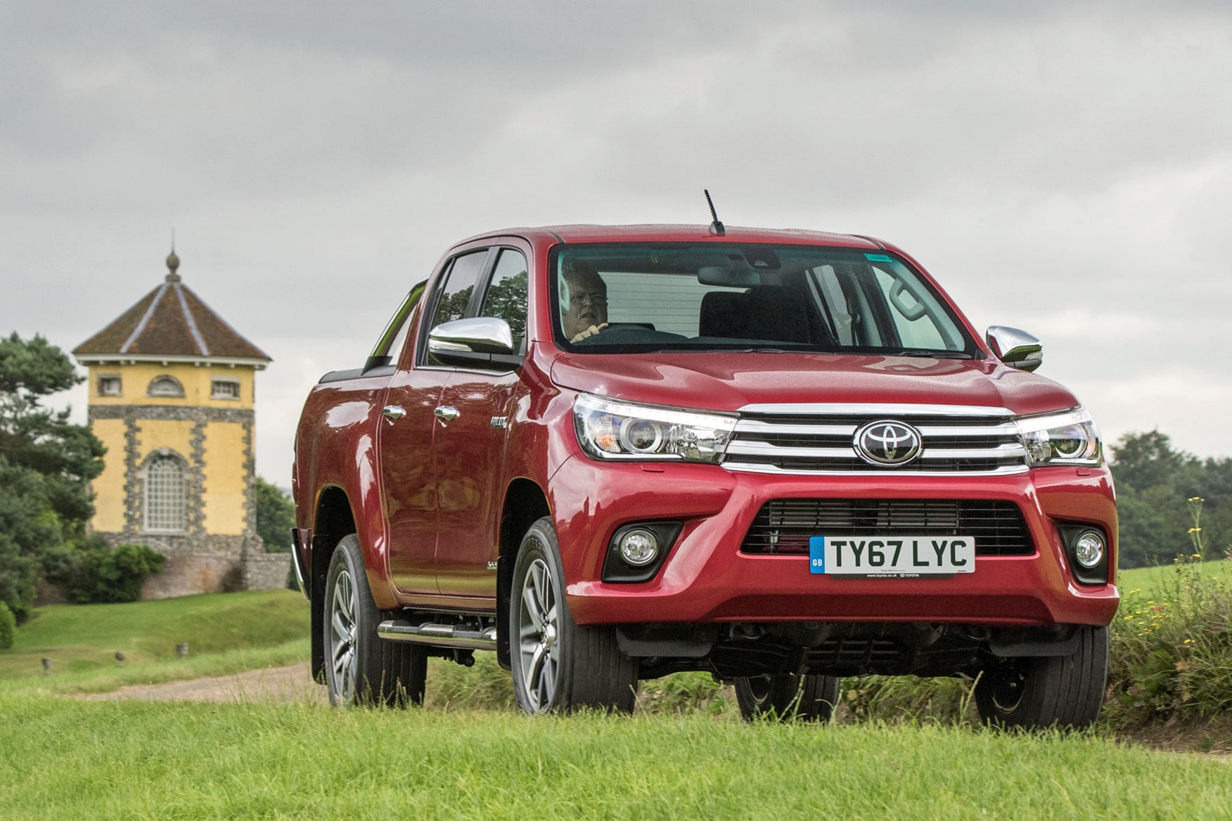 Toyota Hilux review - front view, driving, red, Invincible