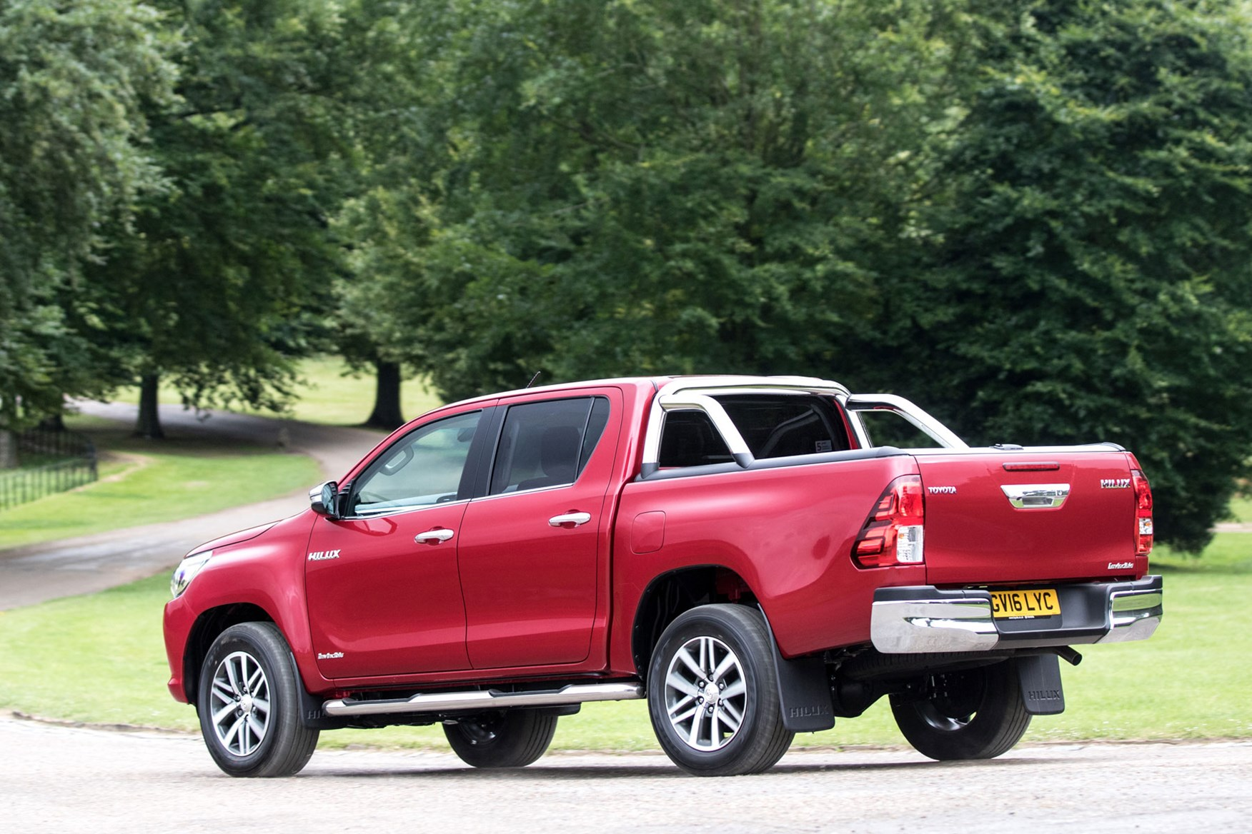 Toyota Hilux review - rear view, driving, red, Invincible