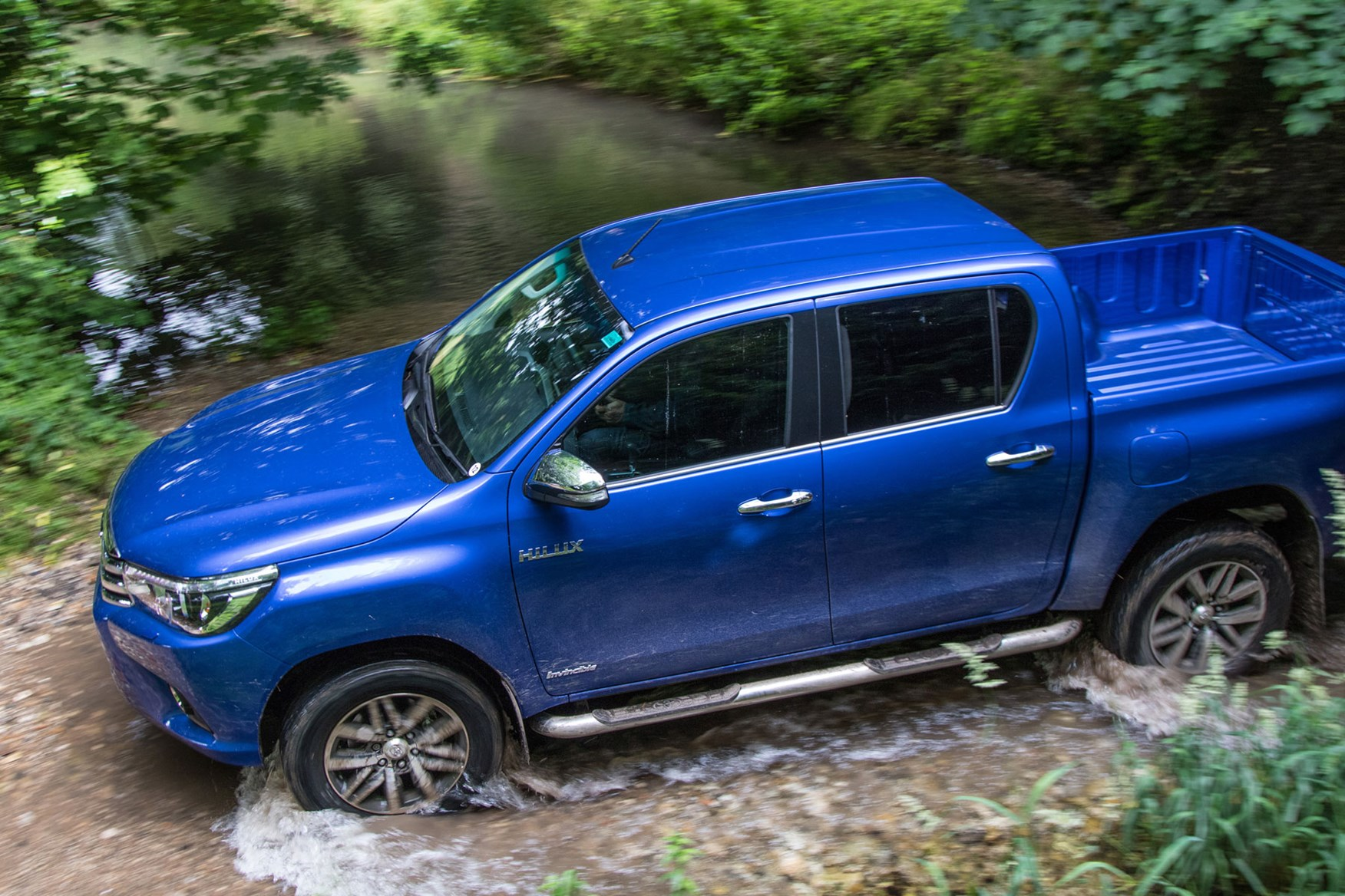 Toyota Hilux review - driving through river, blue, top view