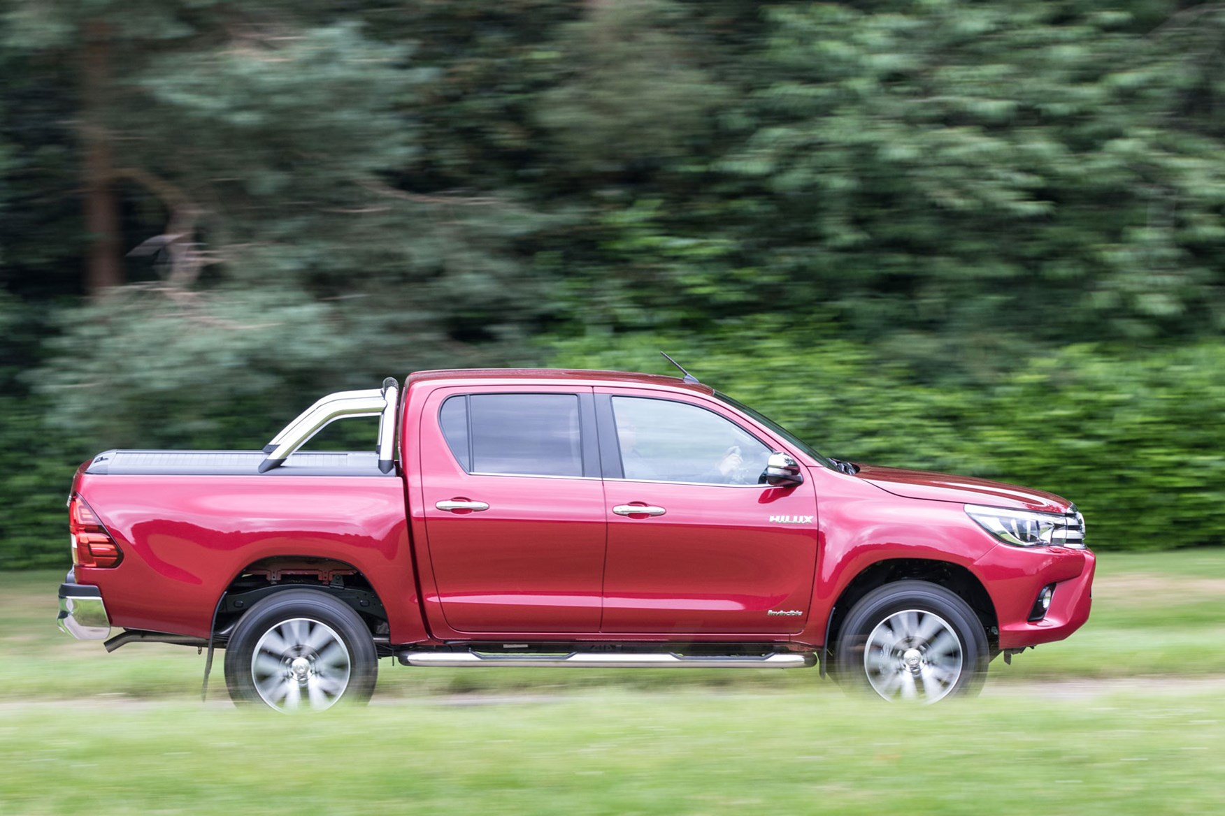 Toyota Hilux review - side view, driving, red, Invincible