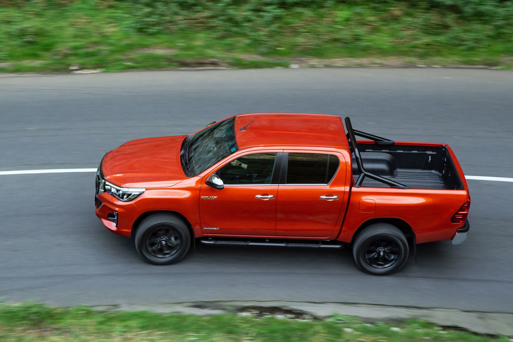 Toyota Hilux Invincible X review - top view, driving, orange
