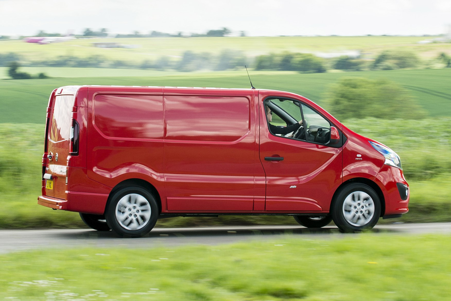 Vauxhall Vivaro review - side view, red, driving