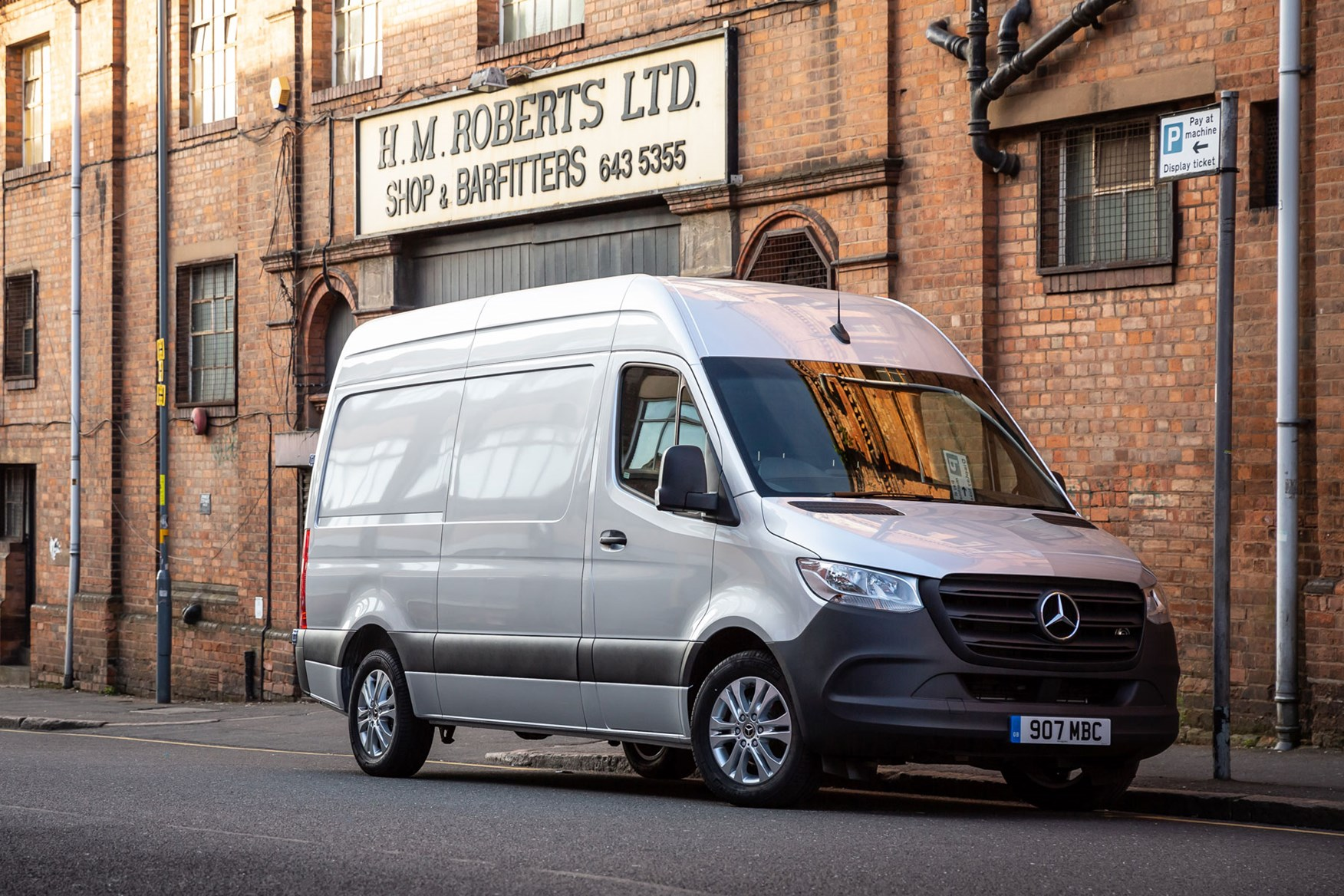 Mercedes Sprinter (2018-on), front view, silver, UK, parked in street