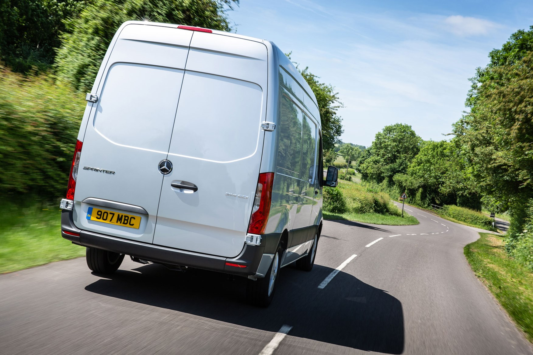 Mercedes Sprinter (2018-on), rear view, silver, UK, driving on country B-road