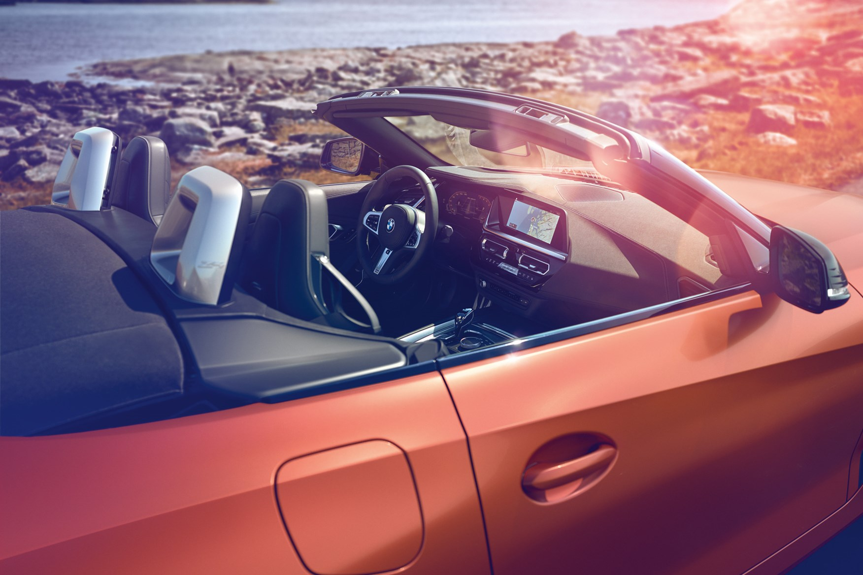 BMW Z4 (2019) with roof down, into cabin