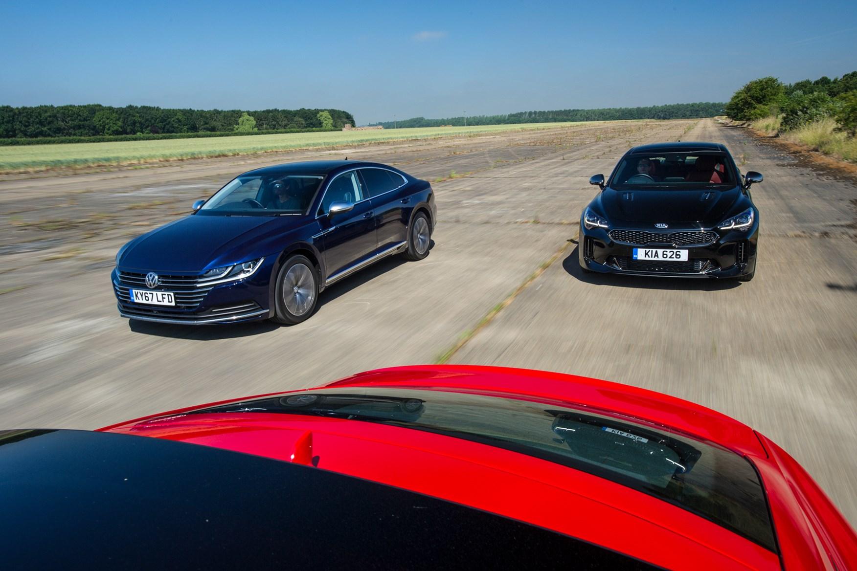Kia Stinger vs Audi A5 Coupe vs VW Arteon driving shot