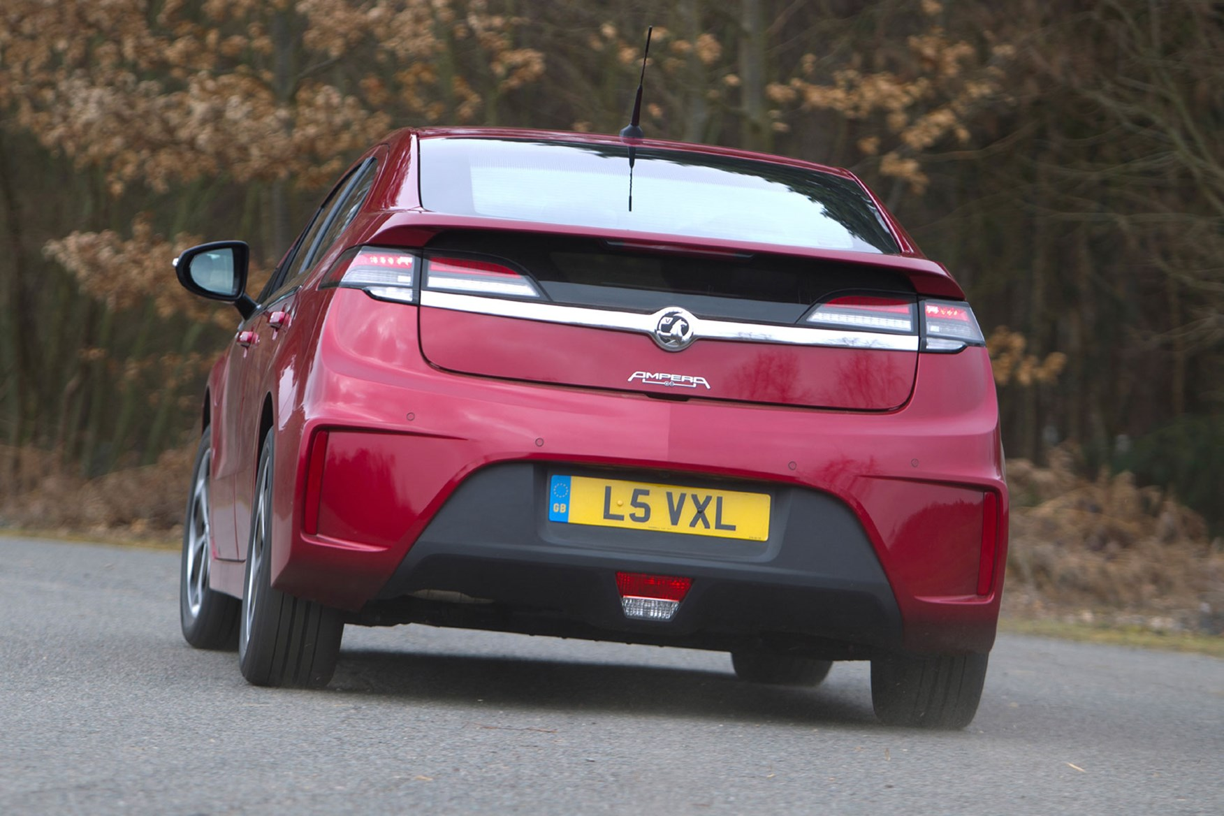 2014 Vauxhall Ampera driving, rear view, red