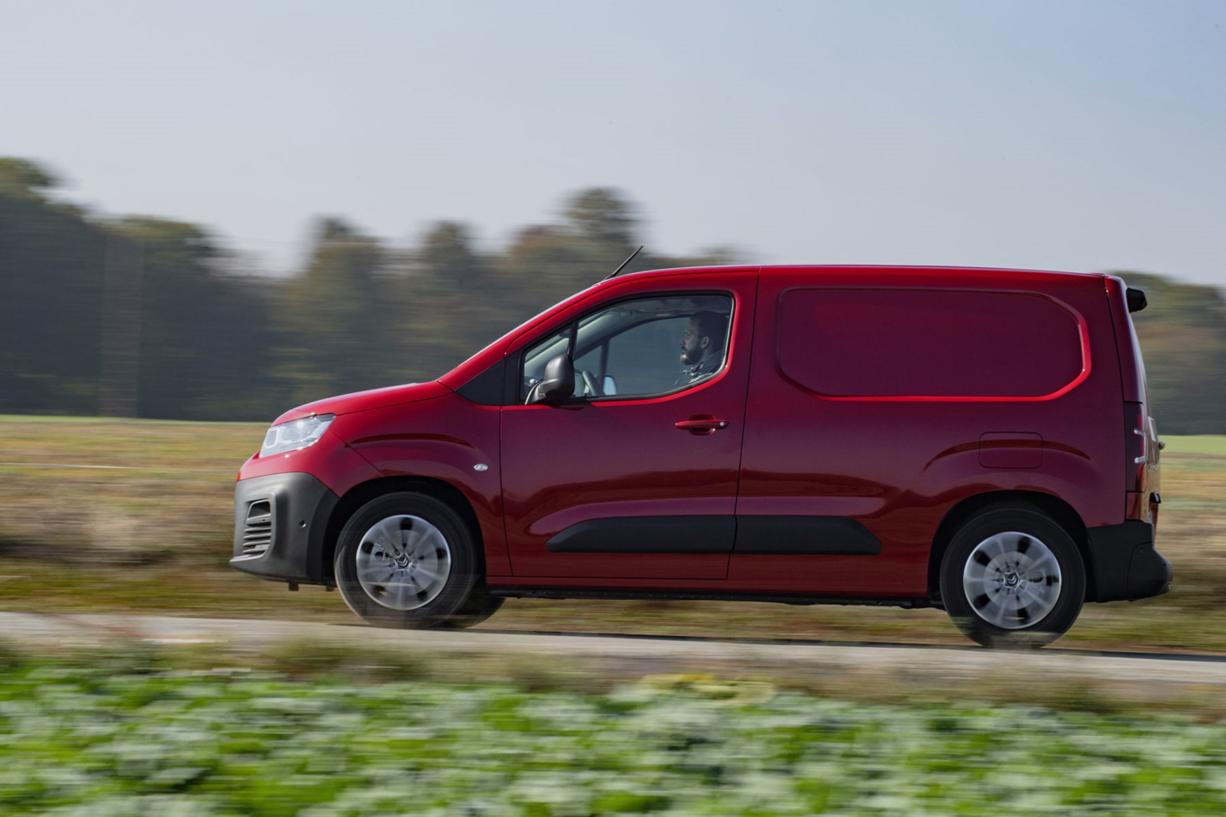 Citroen Berlingo review - driving, red, side view
