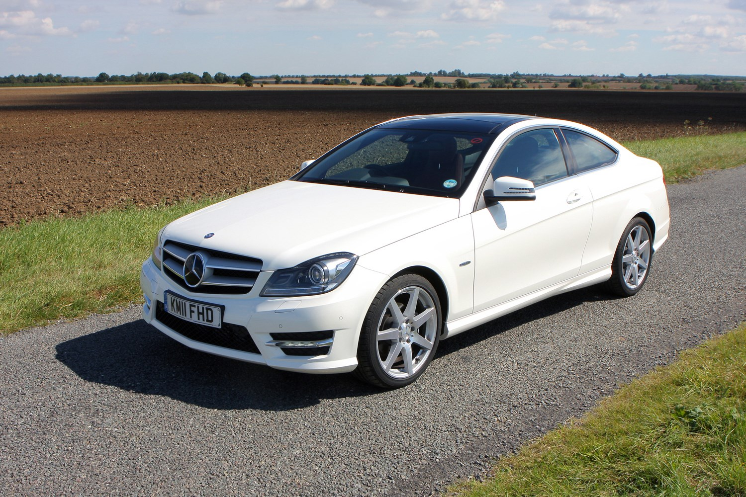 Mercedes benz c class coup 2011 2015 features for How much is a mercedes benz c class