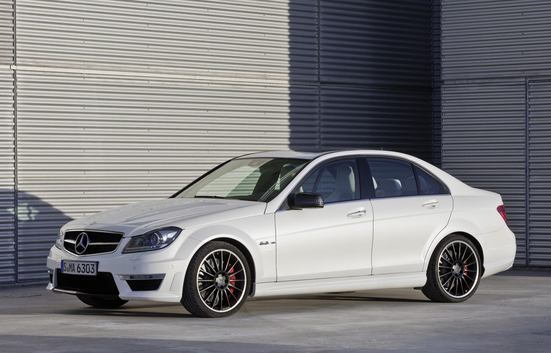 Mercedes benz c class amg review 2011 2015 parkers for Mercedes benz 300 amg