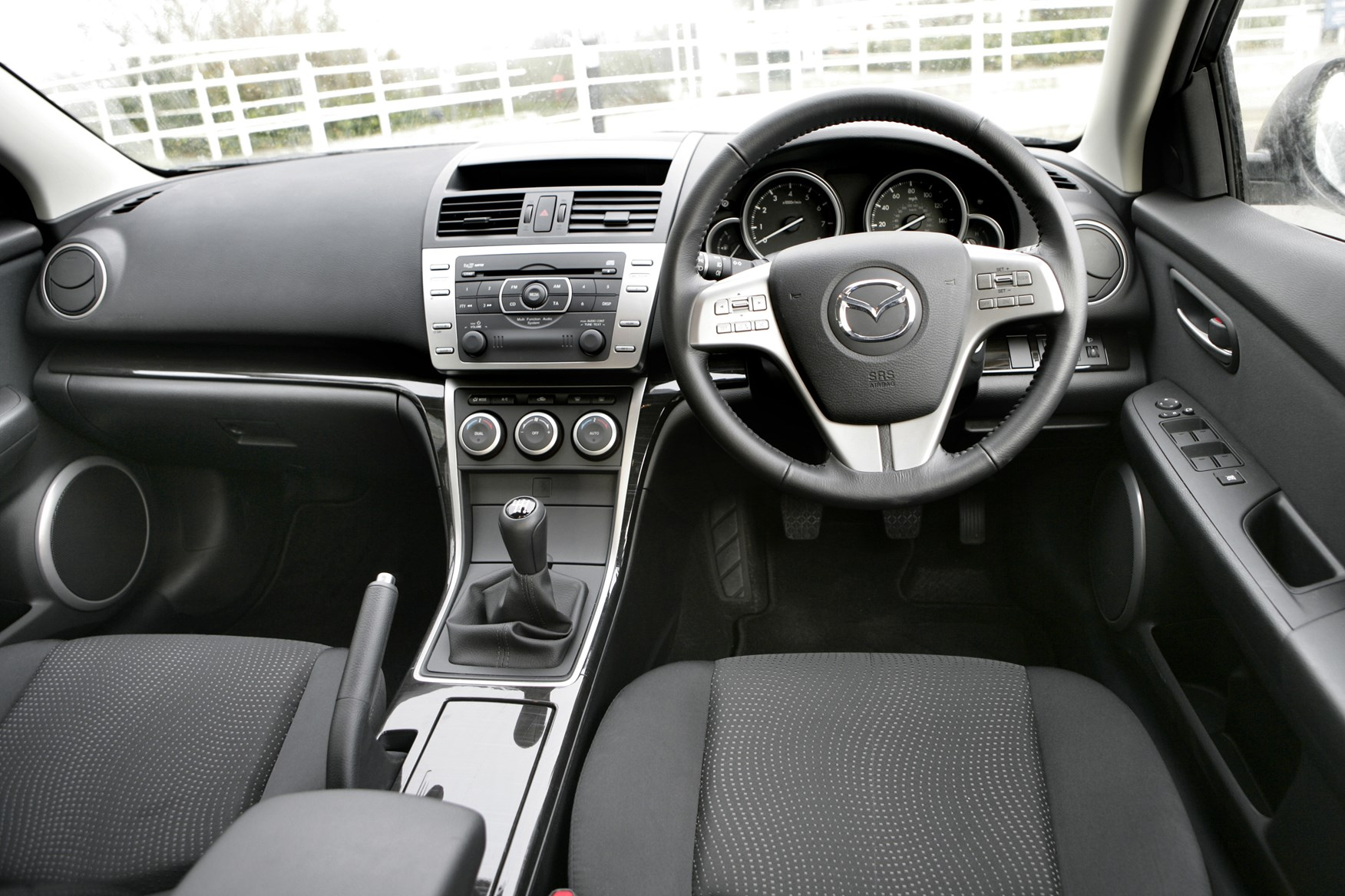 Mazda 6 hatchback 2007 2012 features equipment and accessories parkers for 2012 mazda 3 interior accessories