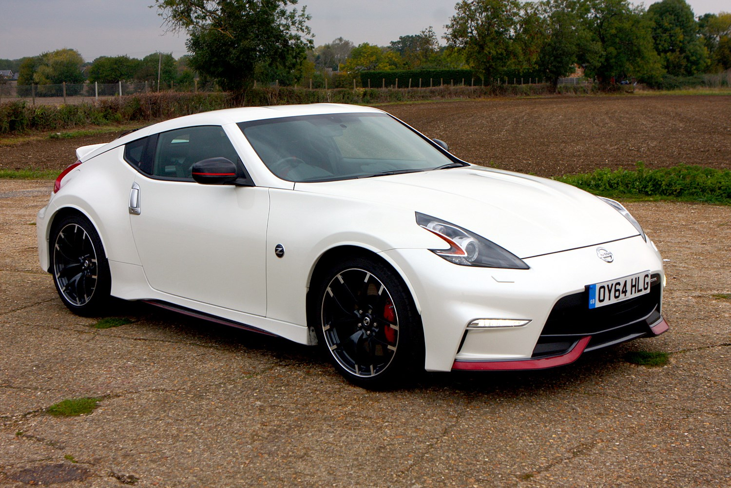 nissan 370z nismo 2013 photos parkers. Black Bedroom Furniture Sets. Home Design Ideas