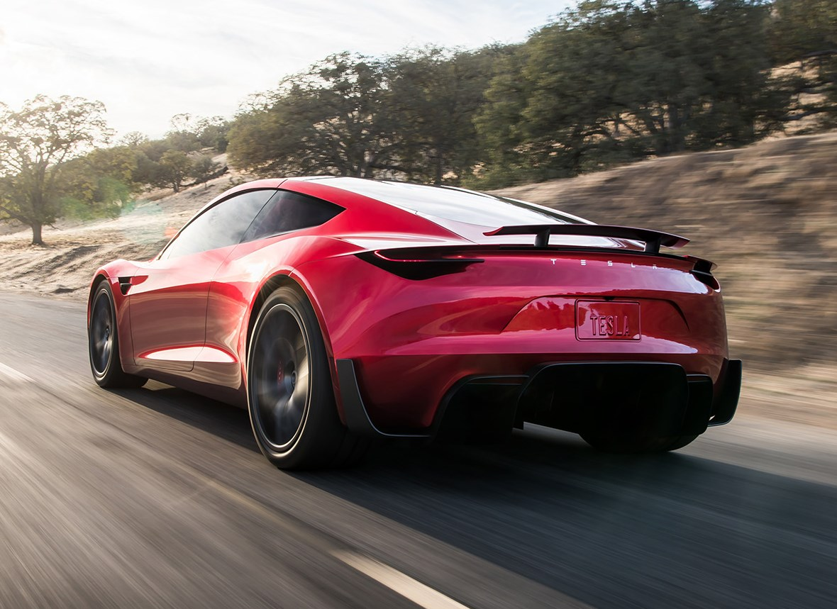 tesla roadster driving exterior 2021 parkers moving