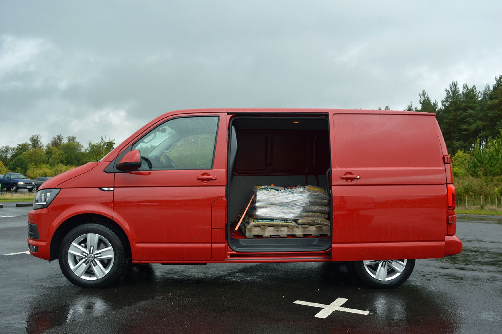 f13489a9a7d ... VW Transporter TDI 102 Highline review - red, side view, doors open, ...