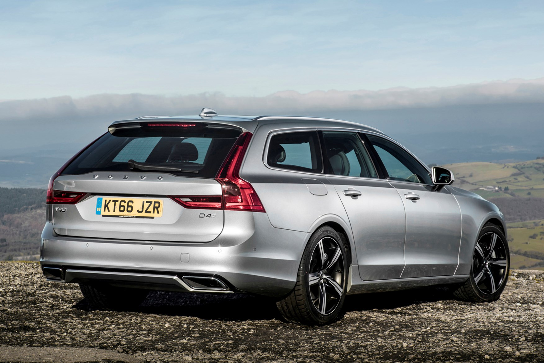 Silver 2016 Volvo V90 rear three-quarter