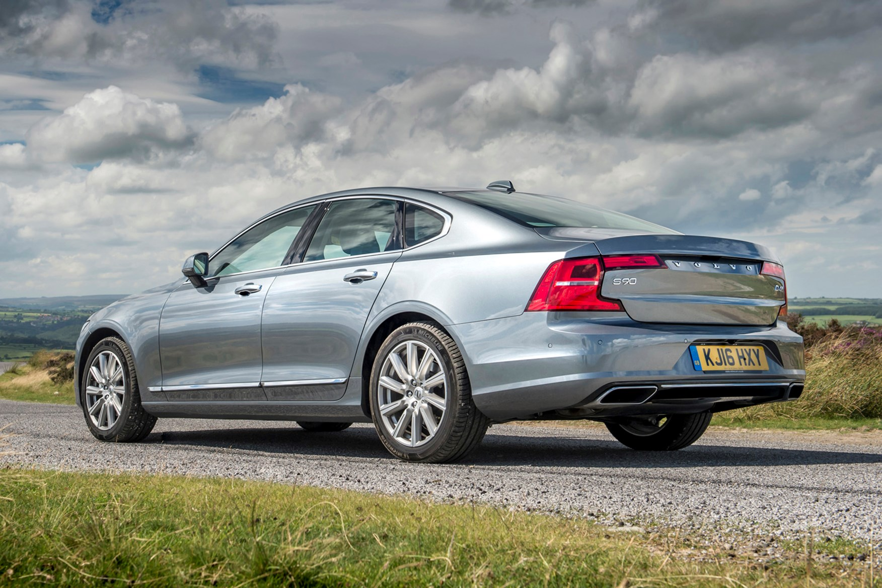 Silver 2016 Volvo S90 rear three-quarter