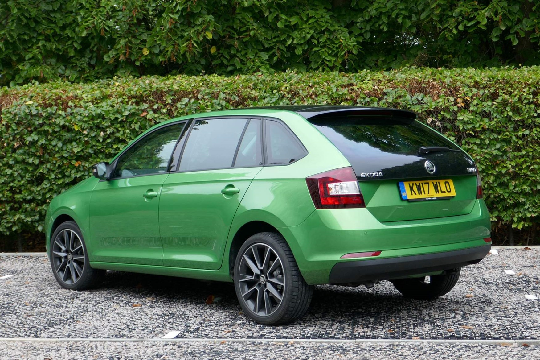 Green 2017 Skoda Rapid Spaceback rear three-quarter