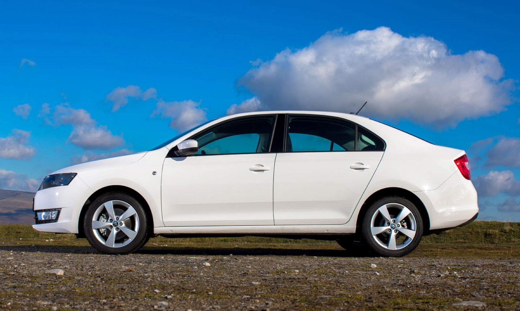 White 2012 Skoda Rapid Hatchback side elevation