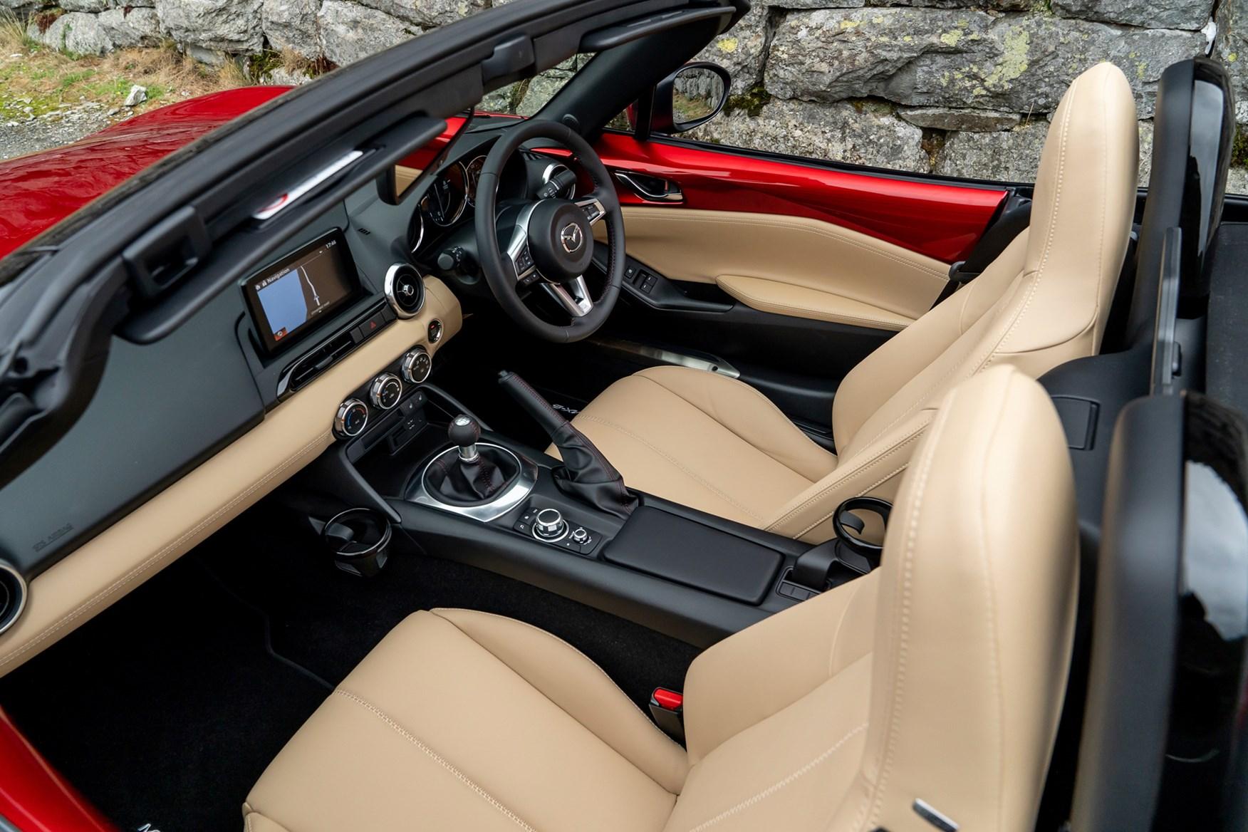Beige 2018 Mazda MX-5 Roadster dashboard and seats