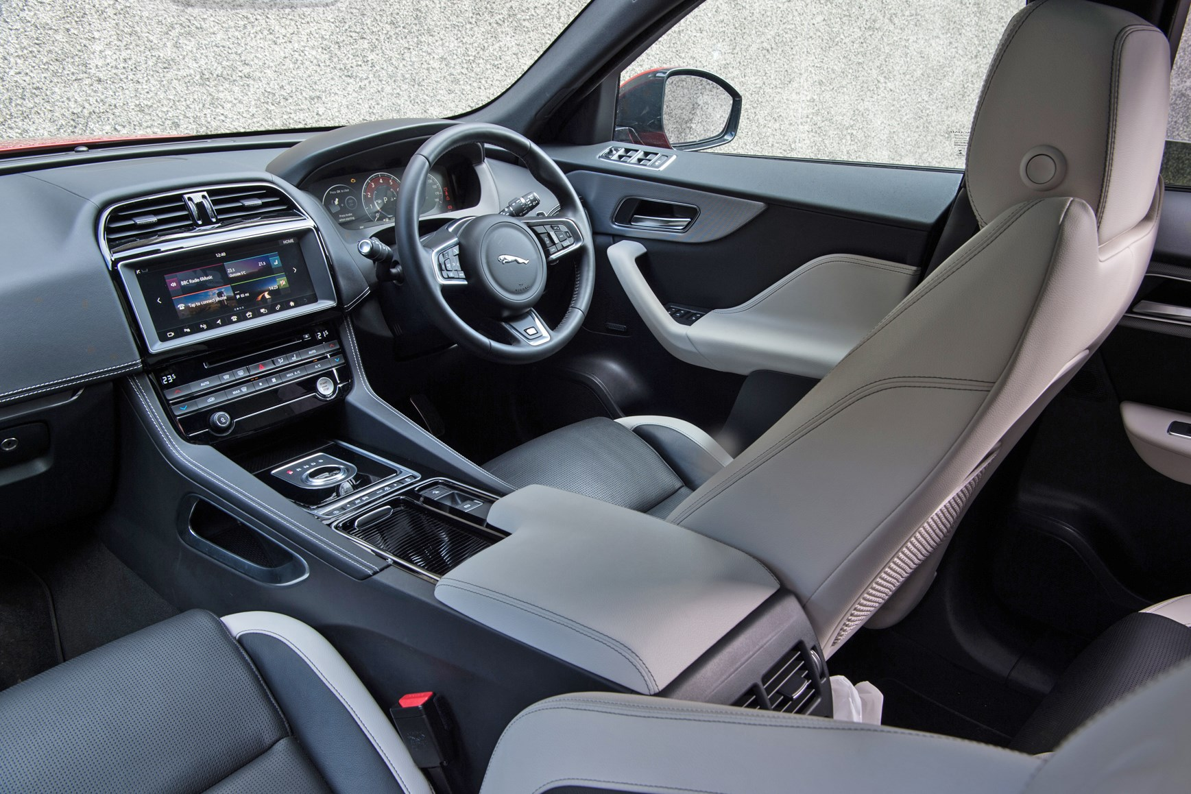Black 2016 Jaguar F-Pace SUV dashboard and front seats