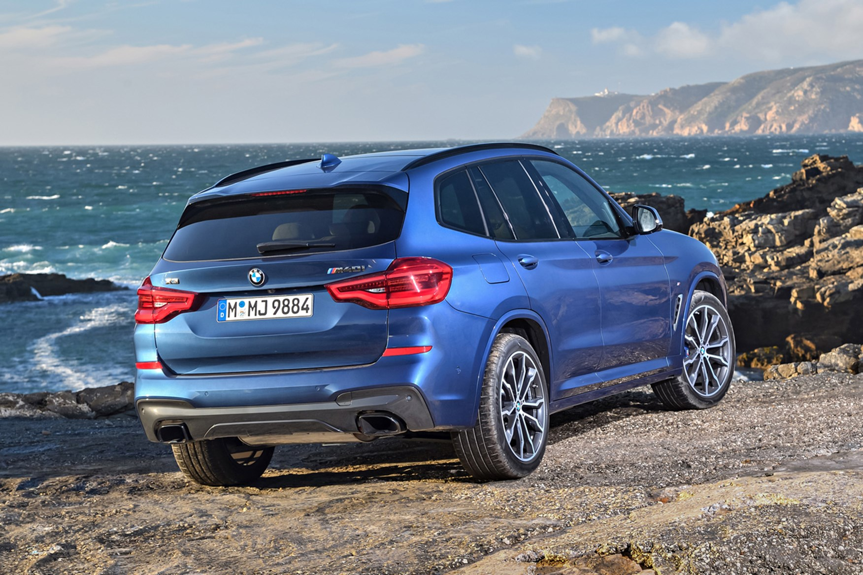 Blue 2019 BMW X3 M40i rear three-quarter off-road