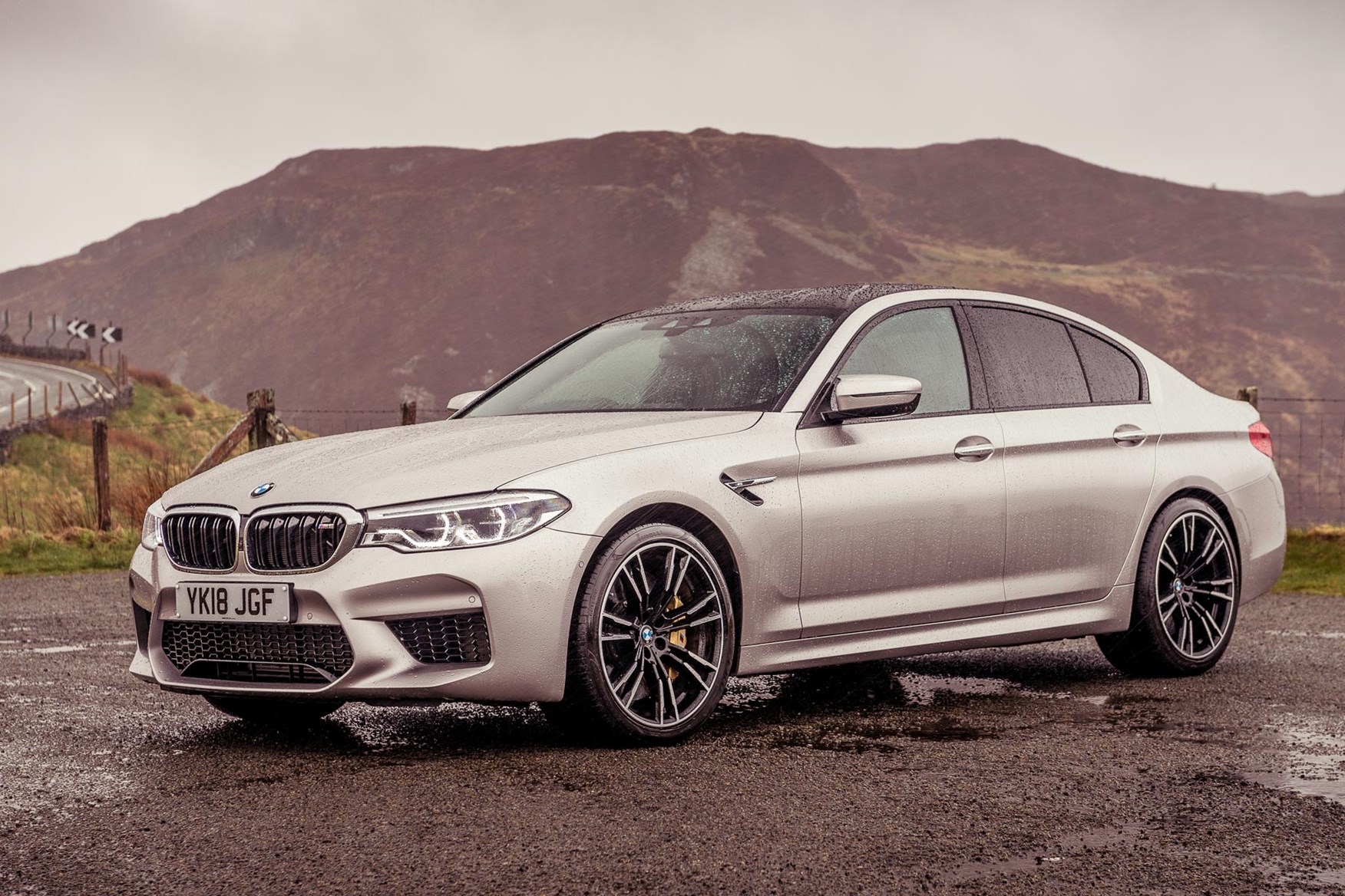 Silver 2018 BMW M5 Saloon front three-quarter