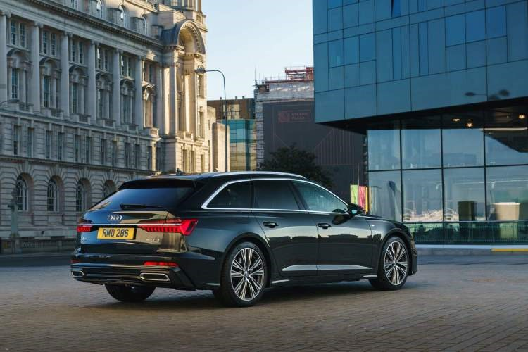 Black 2019 Audi A6 Avant rear three-quarter