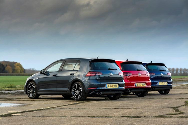 Black, red, and blue Volkswagen Golfs
