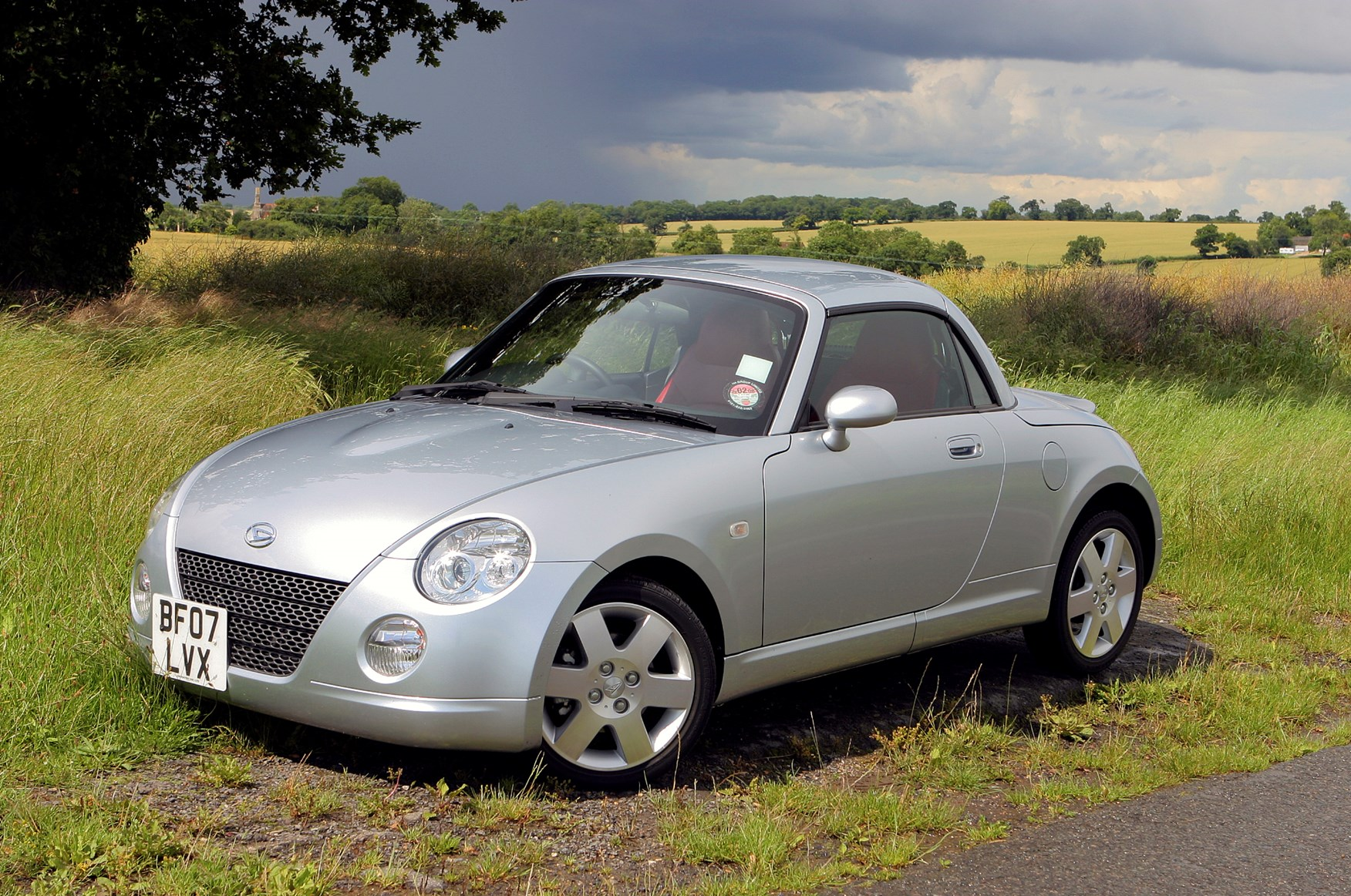 daihatsu copen coupe cabriolet 2004 2010 photos parkers. Black Bedroom Furniture Sets. Home Design Ideas