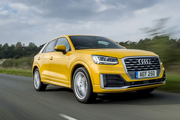 Yellow 2019 Audi Q2 SUV front three-quarter driving